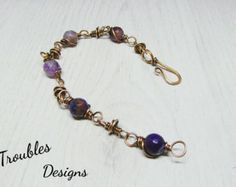 Labradorite bracelet Wirewrap Copper Bracelet Wire wrap bracelet Handmade jewelry Wirewrapped jewelry Wire jewelry Gift for her  The bracelet is made in wire wrapping jewelry technique of copper and labradorite . Copper hammered, patinated, polished and lacquered by special varnish. You can clean copper jewelry with a special jewelry polishing cloth to make the metal shiny again. .....................  Proportions: - size adjustable   Do not drop and wet ...................  Jewelry will be…
