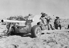6 pounder British anti tank gun goes into action in the desert, fall 1942.