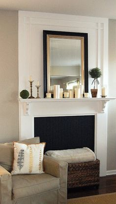 Lots of white candles on mantel