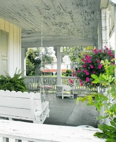 I think a pergola, extra strong to hold a swing on the high upper corner of the deck, maybe attached to the house and anchored in cement on the outer side.  Need a cool swing like this.