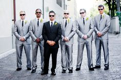 My future groom wants a black tux and his groomsmen to wear gray suits.. .only a darker shade of gray than this. . .