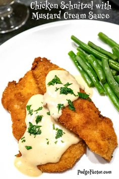 I never met a schnitzel that I didn't like and Chicken Schnitzel is no exception. With a Mustard Cream Sauce added, the Chicken Schnitzel is a restaurant quality dish. The chicken is tender and crispy. The Mustard Cream Sauce is out of this world! Turkey Dishes, Turkey Recipes, Chicken Recipes, Dinner Recipes, Recipes With Chicken Schnitzel, German Chicken Schnitzel Recipe, Drink Recipes, Mustard Cream Sauce, Mustard Sauce For Chicken