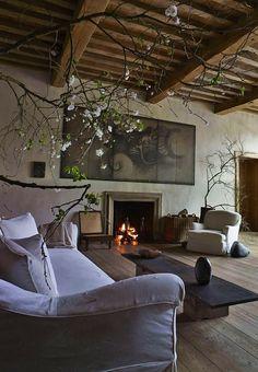 Axel Vervoordt rustic vintage flemish looking living room.  I can imagine Vermeer lounging here.