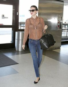 Miranda Kerr Never Has an Off Day — See How She Does It: Miranda Kerr amped up her travel style with a leopard Stella McCartney cardigan ($1,128), glitter Miu Miu shades ($390), and her trusty Givenchy tote after touching down at LAX. : Miranda Kerr showed off sexy travel style in an Equipment sheer leopard blouse with skinny jeans and ballet flats.