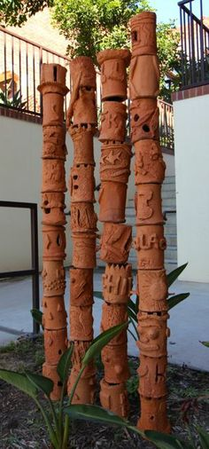 Great xmas kids holiday thing to do - how much fund would that be!!  Clay garden totems