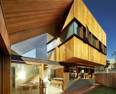 This elegant timber extension uses angular volumes to maximize natural light.