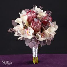 A variety of custom bridal bouquets, centerpiece, and event decor by wedding and event designers at Phillip's Flowers in Chicago and suburbs. Protea Bouquet, Putting On The Ritz, Bride Bouquets, Flower Centerpieces, Wedding Flowers, Wedding Stuff, My Flower, Event Decor, Wedding Inspiration