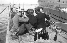 U-boat crew enjoying a drink or two on deck - World War II