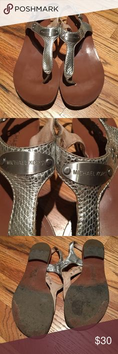 Michael Kors Silver Sandals Michael Kors Silver Leather Sandals. These sandals are in great condition despite how many times I've worn them- very durable! Top silver part is leather, bottom is hard and sturdy. Some scuffing at end of shoes (pic 4) also inside of straps are dirty, but not noticeable when on! Any questions, just ask! Sz 8.5 Michael Kors Shoes Sandals