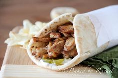 Spiced Shawarma Chicken Wraps - Tender spiced chicken strips layered with tangy pickles and mayonnaise on soft pita bread to create a delicious Middle-Eastern wrap. Chicken Wraps, Chicken Lasagna Rolls, Pesto Chicken, Grilled Chicken, Wrap Recipes, Spicy Recipes, Chicken Recipes, Cooking Recipes, Middle Eastern Dishes