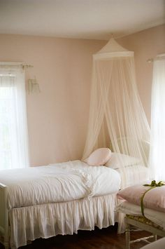 lovely soft pink bedroom.  would love to sleep in here.