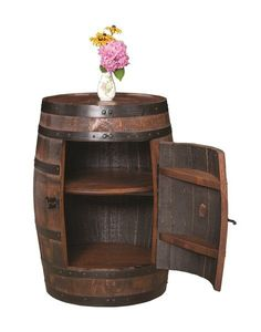 Amish Barrel Cabinet Bring in a truly rustic Barrel Cabinet for unique storage. Beautiful wood barrel with bottom shelf and rotating Lazy Susan inside the cabinet door. Amish made in America. #rustic #barrel #storage