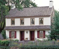 The whitewashed stucco on a circa 1790 stone house in Pennsylvania is accented by earthy browns and reds. (Photo: Gridley + Graves)