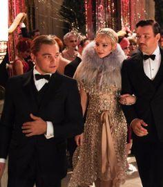 Leonardo DiCaprio as Jay Gatsby, Carey Mulligan as Daisy Buchanan and Joel Edgerton as Tom Buchanan in The Great Gatsby (2013).