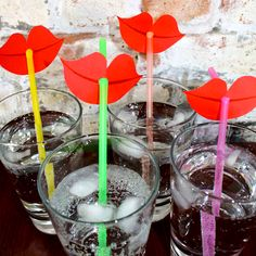 Easy DIY straw decorations! Simply cut out lips on construction paper and hole punch for the straw.