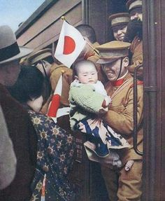 Japanese soldier with his family one last time before leaving for the front in Manchuria (1933)