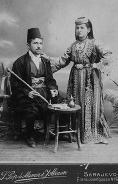 Portrait of a well-to-do couple of Sarajevo (Bosnia and Herzegovina) in formal/ceremonial costumes.  Late-Ottoman urban fashion, end of 19th century.