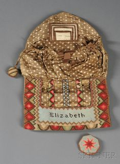 """Canvaswork Sewing Case Pocketbook   Skinner Auctioneers; early 19th century, folding envelope-style pocketbook w/ wool cross-stitched in a lapped scale pattern with geometric border continuing to interior, """"Elizabeth"""" on a leather lined pocket, interior - hand-stitched printed linen with silk ribbon gathered pocket, silk edged woven wool needle holder; 4-3/4"""" x 10"""" (closed); 16-1/4"""" x 10"""" open"""