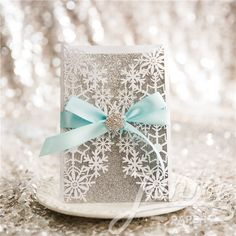 Exquisite Snowflake Laser Cut  Wedding Invitations  with or without ribbon and brooch make a beautiful introduction to your winter wedding. Customize yours with Paper Passionista.