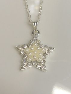 Check out this item in my Etsy shop https://www.etsy.com/listing/275940108/simple-design-silver-plated-star-pearl