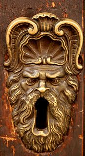 Bologona, Italy...one angry looking key hole! If you put a key in, will it come back out?