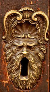 Scrolled Brass God Keyhole: Bologona, Italy