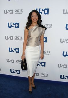 Gina Toress nude satin one-shoulder top looked totally elegant and sophisticated on the actress.