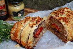 Fennel sausage plait with caramelised onions, roasted peppers and prosciutto