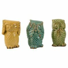 "A whimsical addition to your hallway console table or master suite dresser, these ceramic statuettes showcase charming owl silhouettes and distressed finishes.  Product: 3-Piece statuette setConstruction Material: CeramicColor: Yellow, blue and greenDimensions: 6.5"" H x 3.75"" W x 3.75"" D each (approximate)"