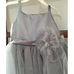 BEAUTIFUL Platinum/Gray Girls' Special Occassion/Flower Girl Dress Size 4Elegant evening dress by Dessy for a special occasion or as a flower girls' dress. This is a unique dress with amazing quality. Hidden zipper. Any little girl will look like a princess in this dress!Worn only 1 time. Like new.Satin top with high waistline. From waistline to floor: 70cm.Original price: $180 USDPriced to sell quickly at only $60.Color:GraySize:4/5Brand:Dessy
