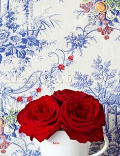 Gorgeous vivid cobalt blue wallpaper with red roses