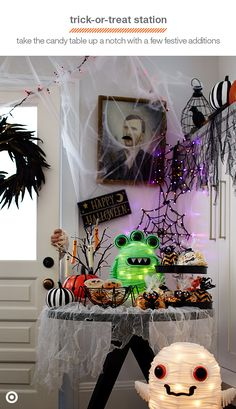 Throwing a Halloween party this year? Balance hosting duties and trick-or-treaters almost effortlessly with a trick-or-treat station. Stock a table by the door with candy and some healthier snack options, top it with some spooky decor, and finish the look with mood lighting, like a glowing ghost and festive alien. You'll be ready whenever that doorbell rings!