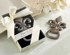For centuries, the fleur de lis has been, among other things, the epitome of uncompromising elegance in design. With our Fleur de Lis Pewter-Finish Bottle Opener, Kate Aspen has married the aura and artistry of a bygone age with the practicality of a kitc Wine Wedding Favors, Elegant Wedding Favors, Bridal Shower Favors, Unique Weddings, Wedding Gifts, Wedding Ideas, Wedding Stuff, Wedding Souvenir, Southern Weddings