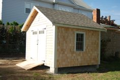 10' x 12' Shed with custom cedar shingle siding, double doors, and double hung window