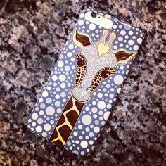 Giraffe phone case doubles as phone camo on granite countertops.