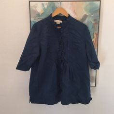Michael michael Kors navy button up Navy button up with ruffle detail, just slightly wrinkled. Armpit to armpit laying flat is 22.5 length 26  💠Bundle to save 20% off 💠No trades, Offsite transactions, or holds 💠If measurements are not listed, I will gladly take them for you. Thank you for stopping by  Thrifterista's  🔶Suggested user• Posh Party Host• 3,200+ sales🔶 MICHAEL Michael Kors Tops Button Down Shirts