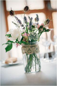 Wild flower centrepieces | Image by Susie Lawrence, read more http://www.frenchweddingstyle.com/chateau-de-la-bourlie/