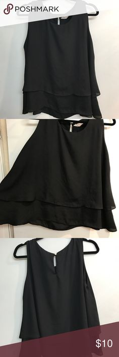 Black shirt Nice elegant black tank top style blouse. In great condition. Not stretchy and good fit. Fits L/XL Tops Tank Tops