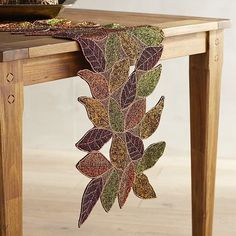 Our handcrafted table runner, embellished with beaded foliage, will dress up your table, meal after meal, year after year.