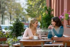 two-women-drinking-coffee-and-tea-in-a-pavement-cafe-picture-id73328582 (507×338)