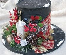 Snowman top hat as centerpiece - made from coffee can spray painted black with battery candle nestled amongst gingham ribbon n sprigs - cute for holiday table setting!