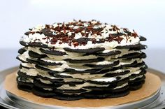 Icebox Cake by Smitten Kitchen:  3 cups heavy cream  3 tablespoons sugar  1 tablespoon vanilla extract  2 (9-ounce) packages chocolate wafer cookies [or, make your own!]  Unsweetened cocoa (or chocolate shavings)  (Also see recipe for Chocolate Wafer Cookies)