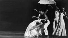 """Accord to Jack Mitchell, the famous white umbrella used in Alvin Ailey's Revelations came about when Ailey and company went to Mitchell's photo studio for some production shots. During the shoot Ailey decided he really liked the white reflective umbrella Mitchell was using for lighting, and """"borrowed"""" it."""