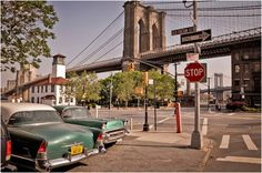 Two old cars parked by the Brooklyn Bridge on Old Fulton Street, #Brooklyn, NY