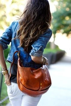 classic: white jeans, denim shirt and brown messenger bag