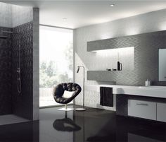 Artistic Tile | Curl Black Silver White Bathroom | CURL's three dimensional wave patterns give movement and energy to vertical surfaces, for a contemporary aesthetic that's organic, yet precise. A glazed porcelain, CURL is an attractive option for both residential and commercial projects.