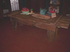 Here is a rustic coffee table, I made out of a old barn door, for my shop