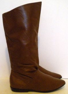 Sz 7 Vintage brown tall leather flat pirate boots.. $45.00, via Etsy.