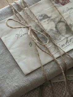 Christmas linen and string (some other cute wrapping ideas and decorating/crafts too at this site)