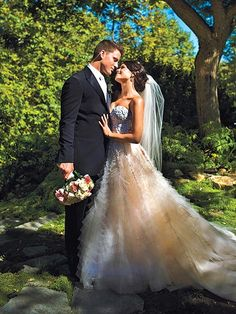 Channing Tatum and wife Jenna Dewan-Tatum wedding dress in a pastel-and-ivory Reem Acra couture ball gown.